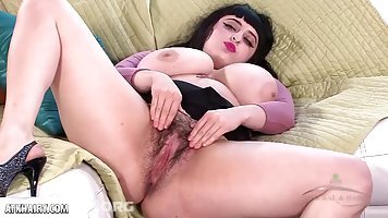 Big titted brunette, Daisy Gold is showing her hairy pussy and stimulating it with a vibrator
