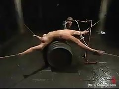 Gagged babe, Christina Carter is being chained and tortured in her friend's basement, just for fun
